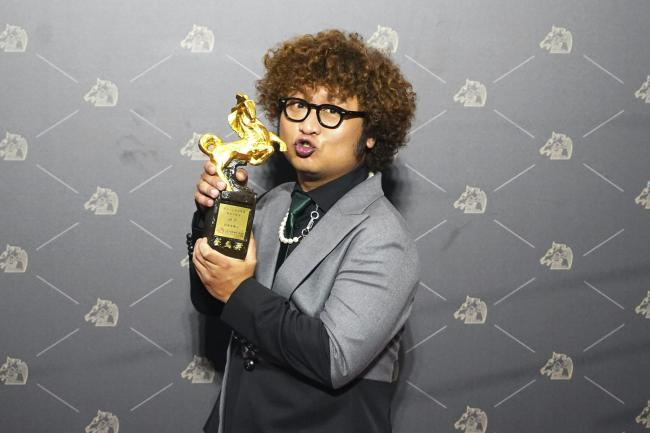Taiwanese actor Nadow Lin holds his award for best supporting actor at the 57th Golden Horse Awards in Taipei, Taiwan