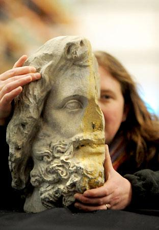 Susan Harrison, of English Heritage, pictured behind the Roman bust of the god Jupiter