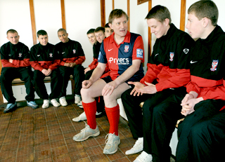 York MP Hugh Bayley chats with members of the York City youth team in the home changing room at Bootham Crescent