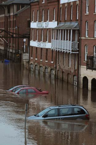 Cars submerged by flood water from the River Ouse on Queen's Staith in York.
