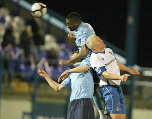 Djoumin Sangare rises high above the Barrow defence but his header goes off target. Picture: Gordon Clayton