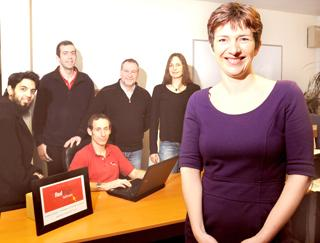 Jane Tyler, right, of Redblack Software, with some members of her team, from left, Muneeb Waseem, Chris Roberts, Andy Throup, Keith Hillsden and Andrea Duempelmann.
