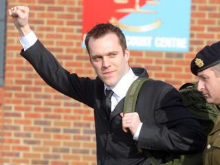 Lance Corporal Joe Glenton is led away from court after being sentenced to nine months in a military prison for going AWOL and refusing to return to Afghanistan