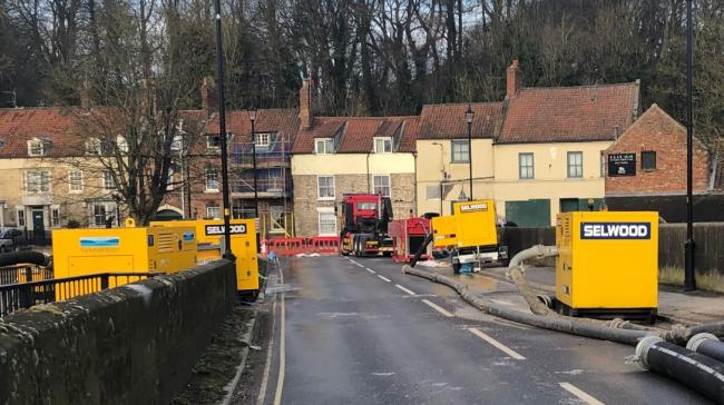 County Bridge between Malton and Norton with pumps and road closure cones