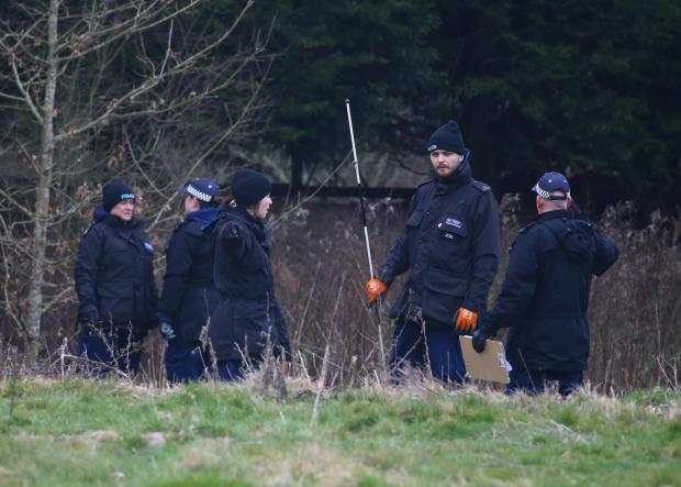 York Press: Officers from the Metropolitan Police search woodland near to Great Chart Golf and Lesiure in Ashford, Kent, on Wednesday