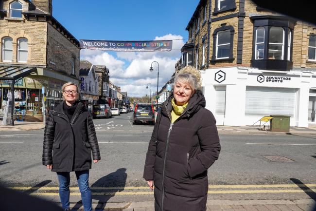 Harrogate BID chair, Sara Ferguson, left, and retailer, Sue Kramer, in front of the new Commercial Street banner in Harrogate.