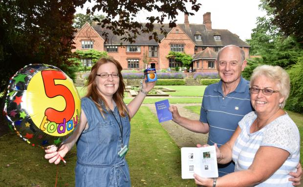 York Press: PHOTO TAKEN IN 2017: Celebrating five years since the National Trust opened Goddards House and Garden, the Terry family home, to the public are (l-r), Becky Roberts , Visitor Experience officer and Michael and Susan Green, who were the first visitors to the house 5 years ago when it opened pictured with their National Trust Passports Picture Frank Dwyer.