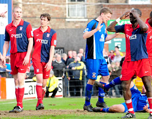 York City centre-back Djoumin Sangare has his head in his hands after  seeing a late effort clear the crossbar as his side were held to a 1-1 draw by lowly Tamworth in the Blue Square Premier at Bootham Crescent on Saturday.