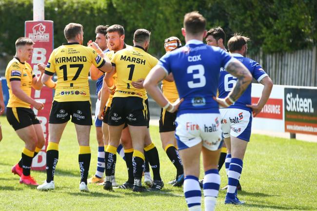 York City Knights celebrate scoring against Swinton Lions. Picture: Craig Hawkhead
