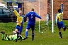 Haxby United striker Chris Dyson celebrates after beating Old Malton 'keeper Andy Slaughter