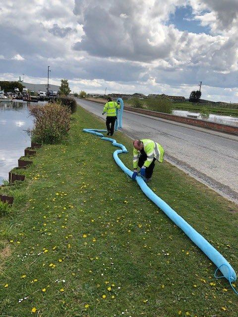 Environment Agency staff tackling the oil spill problems at a marina in Goole