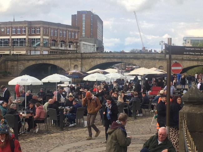 Crowds of people enjoy fine weather on Kings Staith yesterday: there will be more sunshine today before heavy rain sweeps in tomorrow  Picture: Mike Laycock