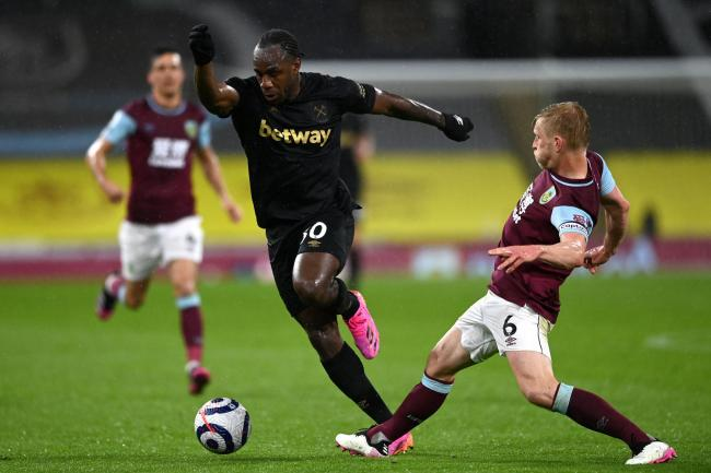 Michail Antonio (centre) in action for West Ham
