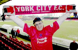 CONTROVERSIAL: John Batchelor celebrates his takeover of York City at Bootham Crescent in 2002