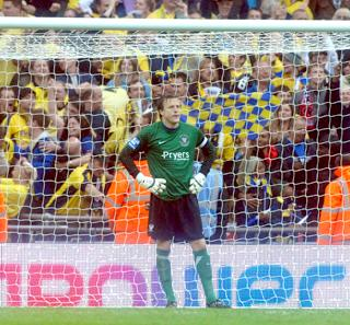 City skipper and goalkeeper Michael Ingham is downcast after Oxford's third killer goal