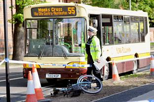The scene after the collision between a cyclist and bus in Fulford, York, last night