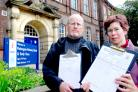 Mark Harcroft and Candida Spillard with a petition outside Fishergate Primary School in York