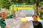 Yormed ambulance technicians Ashley Mason, left, Danny Watt and trainee Chris Chadwick, right, with the Life Savers vehicle signs