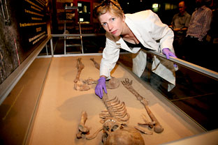 Osteologist Malin Holst carefully lays out the bones of a gladiator, some of which contain teeth marks of a carnivore believed to be a lion, at the Jorvik Viking centre in York