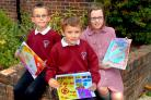 Pupils at Carr Junior School with some of the entries to a competition aimed at getting a dog dirt bin located outside their school.