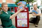 YorMed ambulance technician Ashley Mason, left, highlights the Lifesavers campaign with Gavin Aitchison, news editor of The Press, in St Sampson's Square, York