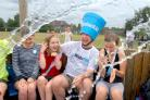 Our picture shows teacher Adrian Mann getting a soaking from pupils