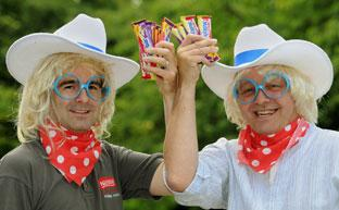 Nestlé employees Phillip Ashley, left, and Steve Cloquhoun, dressed to promote the launch of the new Milkybars