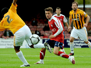 York City trialist David McDermott battles for possession with Hull City's Nolberto Solano, left, in Saturday's pre-season friendly at Bootham Crescent