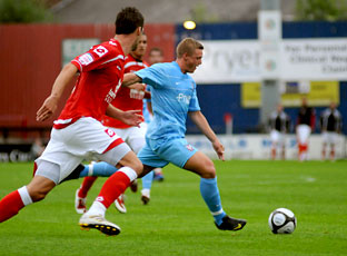 York City striker George Purcell unleashes a shot against Barnsley