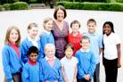 Pupils at Clifton Green Primary School give head teacher Sheila Audsley a good send off
