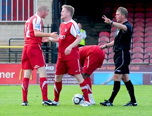 York City substitute Michael Rankine places the ball on the spot as regular penalty-taker Richard Brodie has a heated discussion with Michael Gash during the 2-1 Blue Square Bet Premier defeat to Kidderminster Harriers at Bootham Crescent on Saturday