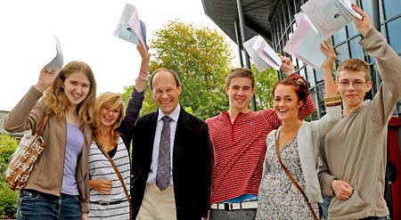 Archbishop Holgate's School GCSE results. Pictured with some of his former students is retiring head teacher John Harris