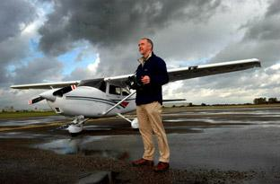 Dave MacLeod, English Heritage's senior investigator, prepares for a survey flight from the airfield at Sherburn-in-Elmet