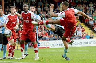 Substitute Leon Constantine scores York City's second goal against Rushden & Diamonds