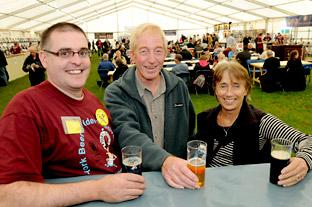 York Press: Matt Grant, chairman of York Camra, enjoys a beer at the York Beer Festival with Phil and Jackie Williamson, who own and run the Ferry Boat Inn at Thorganby which this week won the Yorkshire CamraPub of the Year Award
