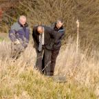 York Press: HUNTING FOR CLUES: Detectives at the scene after the body of Cai Guan Chen was found in the canal at Burn