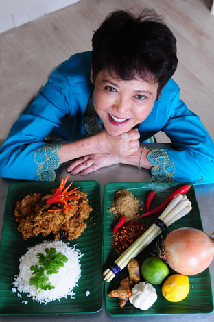 Jennie Cook seen with the ingredients for Beef Rendang and the finished dish