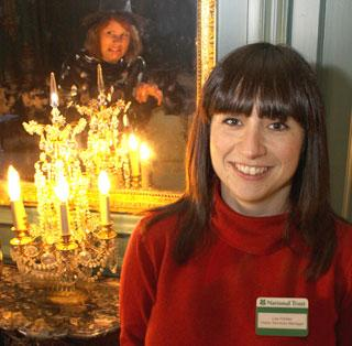 TRAIL: Lisa Holden, visitor services  manager, places candles to mark out the halloween trail at the Treasurer's House