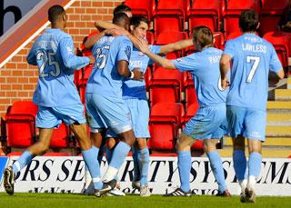 York City  players  converge on goalscorer Danny Racchi after he bags the opening goal against Kidderminster Harriers at Aggborough