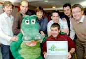SNAPPY the crocodile sitting with Tom Smith and the other Monkeys, from left,  Rick Jesse, Pierre Andrews, Val Seddon, Guy Redwood, Ben Miller and Darrell Hooper, of Science City York
