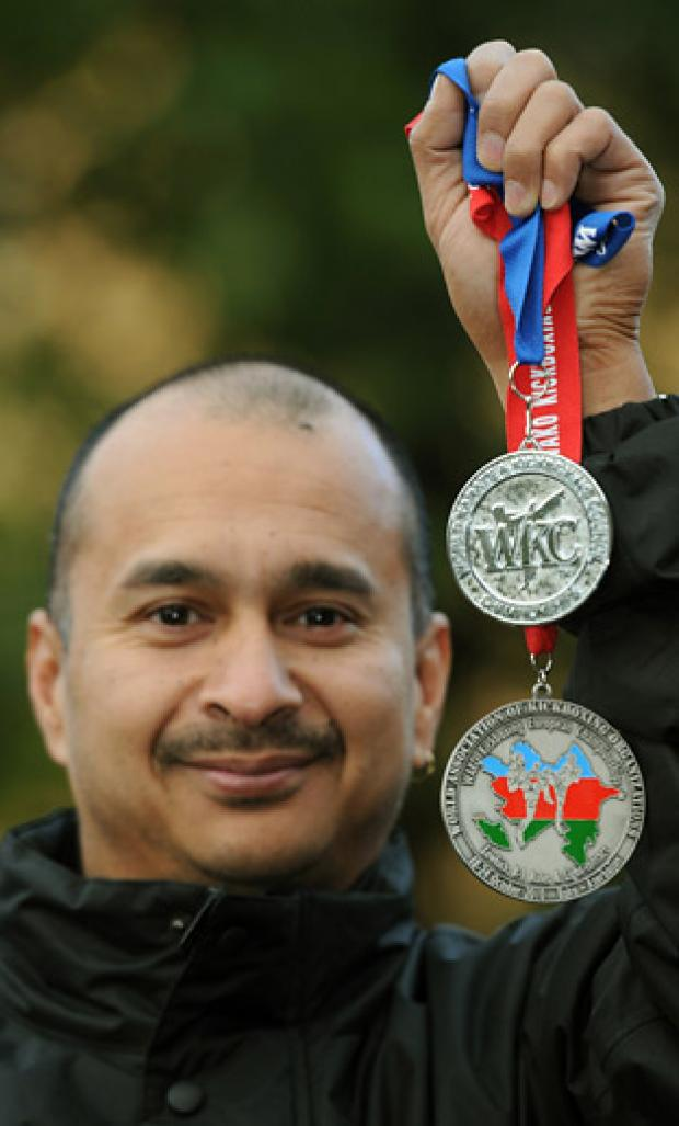 Kick-boxer Tony Dias is pictured with his silver medals from Portugal and Azerbaijan