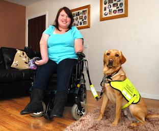 Hollie Byrnes, who has been nominated in the Spirit of Youth category in the Community awards, with her  assistance dog, Hilton