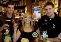 Toasting their inclusion in the Good Beer Guide at the Brigantes are Paul Burton, left, Becky Milner and manager Rob McCune