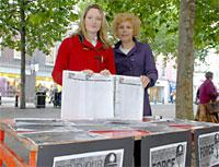 Anna Bevan, left, and Emily Hodgson collect signatures at the Fund Our Force stall in Parliament Street