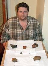 Chris Bevan with some of the pieces of pottery he has found in his garden