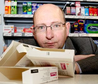 James Downing, the pharmacist at the Asda store at Monks Cross in York, with some of the empty flu vaccine boxes left after scores of people went in to get a jab