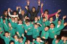 Head teacher Lesley Barringer, rear  centre, joins fellow staff members and pupils to express their delight with the recent Ofsted report on Osbaldwick Primary School, York