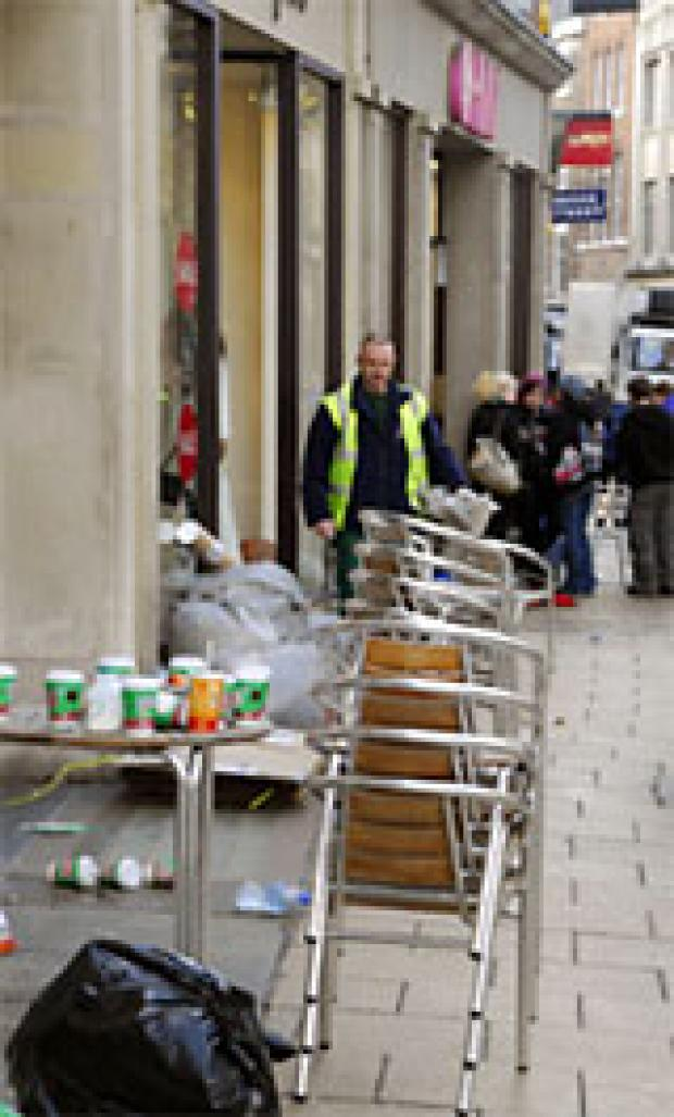 York Press: Street cleaning officer Paul Willey clears up the mess in Coney Street, York