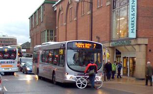 A cyclist stages one-man protest in front of a bus in Piccadilly. Picture by Tim Stark