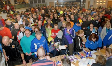 Competitors queue for their timing chips before the Brass Monkey run